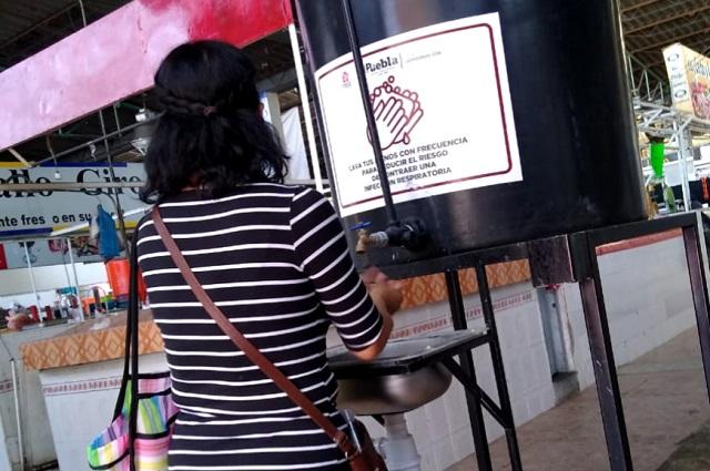 Colocan 42 lavamanos en mercados municipales de Puebla