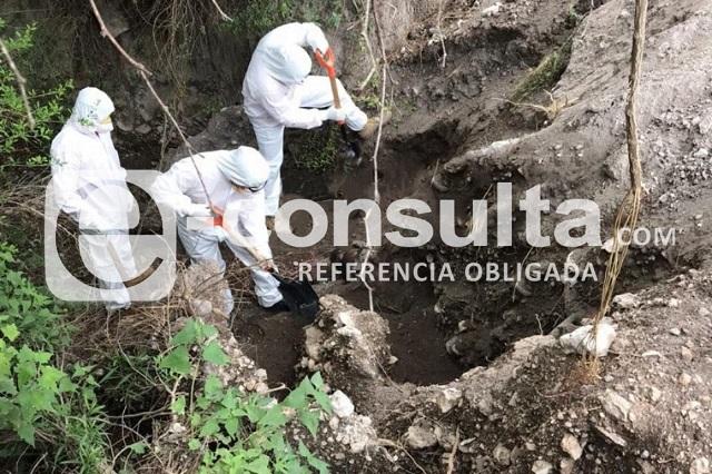 En barranca de Tlacotepec de Juárez hallan cuerpo putrefacto