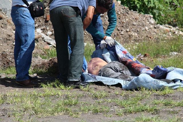 Golpeado y con una bolsa en la cabeza hallan cadáver en Ocoyucan