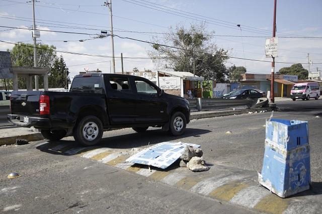 Defensores de activista preso liberan carril de la México-Puebla