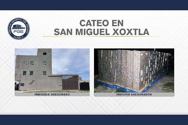 En cateo en Xoxtla recuperan 94 mil latas de atún robadas