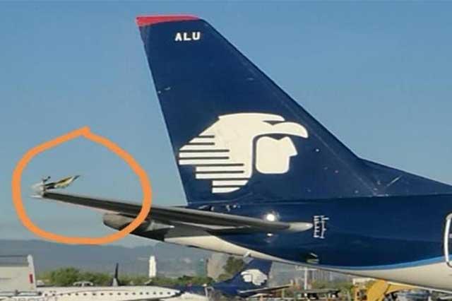 Activan protocolo de seguridad en el AICM por roce de alas de 2 aviones
