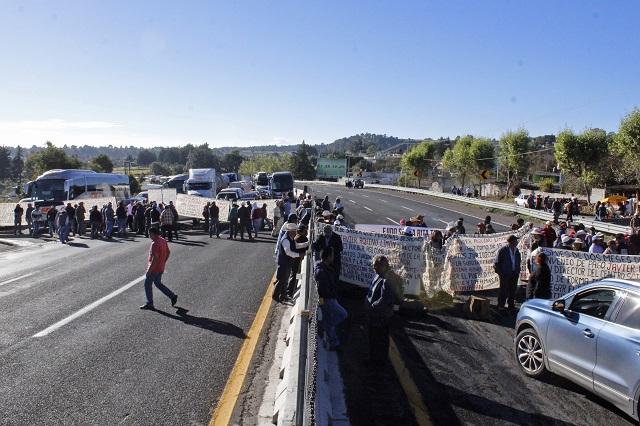 Tras nuevo bloqueo, SCT paga 179 mdp por autopista México-Puebla