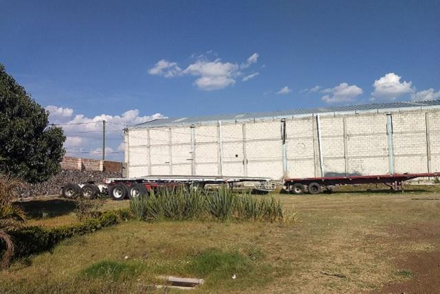 Gracias al GPS policía llega a bodega con vehículos de carga robados