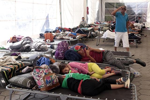 Llegan a Puebla 600 migrantes centroamericanos; van a CDMX