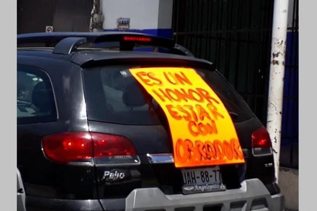 Opositores y seguidores de AMLO realizan caravana en Atlixco
