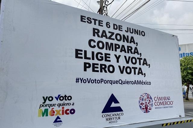 Con caravana, empresarios buscan que la gente salga a votar