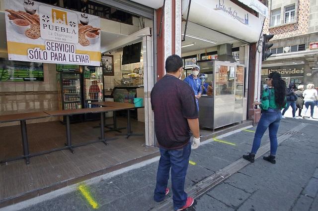 Bajo restricciones sí reabren negocios en el centro de Puebla