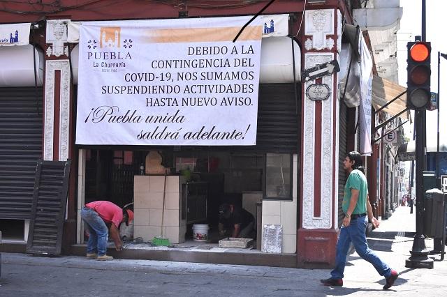 Cierran 1 mil 500 negocios en el centro de Puebla por contingencia