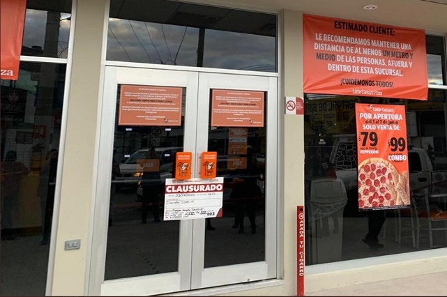 Clausuran pizzería el mismo día de su inauguración en Texmelucan