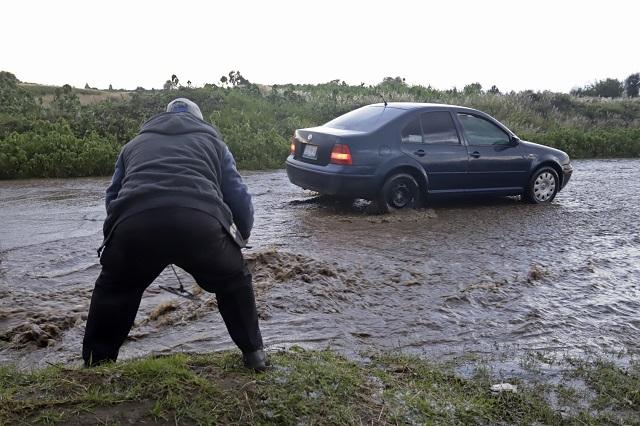 Huracán Elida aumenta lluvias en Puebla,  Oaxaca y Veracruz