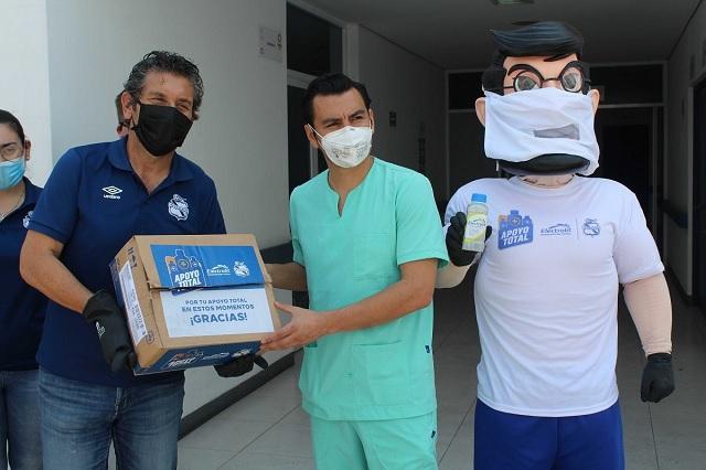 Club Puebla brinda apoyo a trabajadores que laboran en las calles