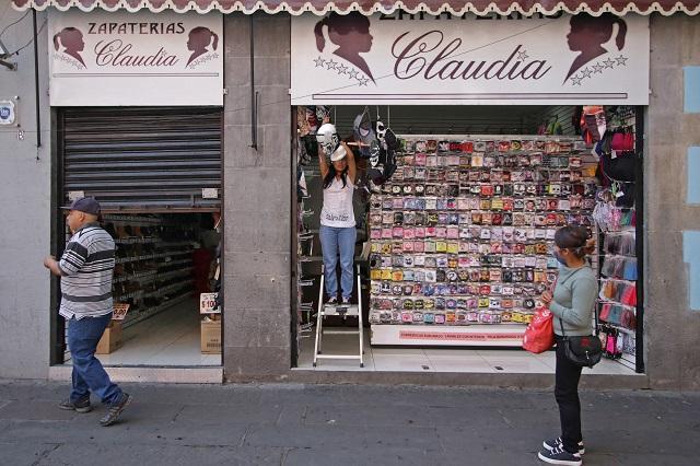 Para sobrevivir, reabren negocios del centro de Puebla