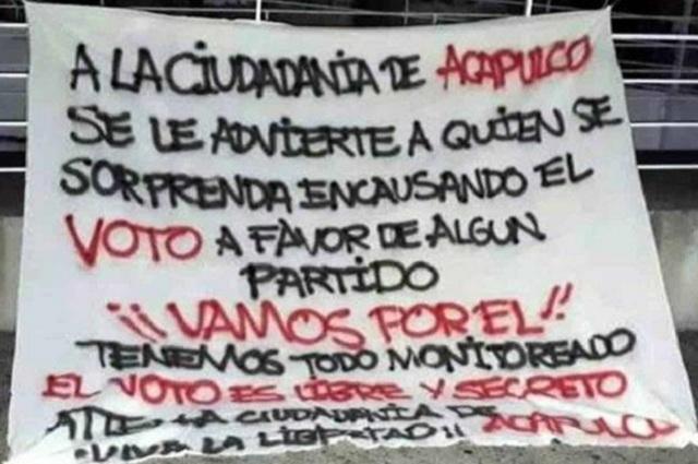 Cuelgan mantas en Acapulco con amenazas para quien compre votos