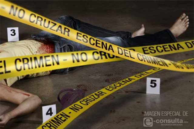 Indagan crimen de un hombre y agresión a mujer en Cholula