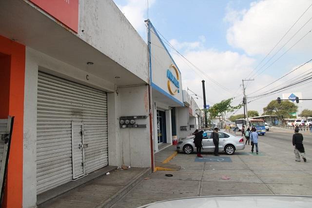 Vandalizan local en intento de robo a negocio en Puebla