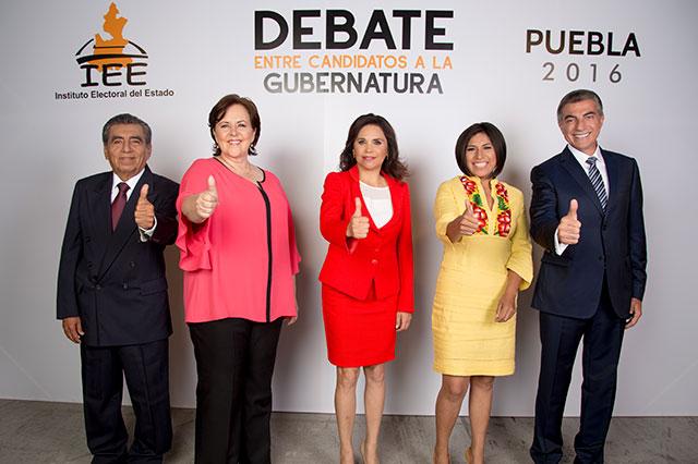 Sueltan candidatos golpes en debate sin llegar al nocaut
