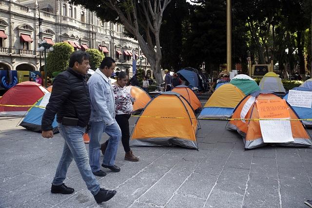 Mudan su plantón despedidos del ayuntamiento de Puebla