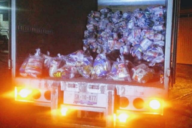 Detectan camiones con despensas del PRI en Texmelucan e Izúcar
