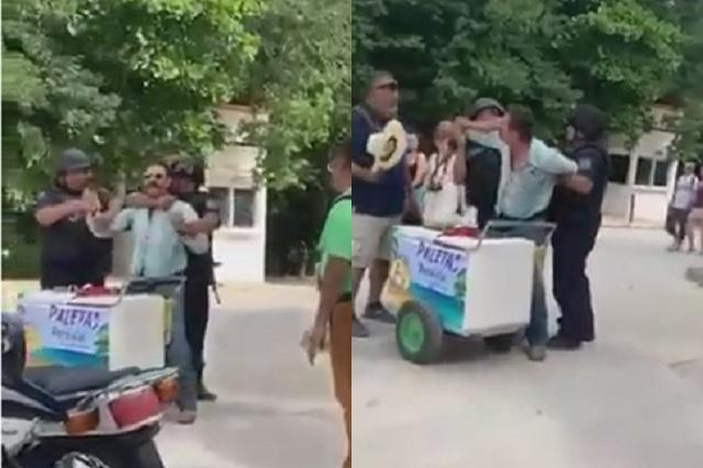 Graban a policías que detienen y someten a hombre por vender paletas en la calle