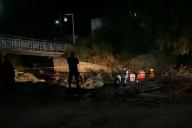Hallan cuerpo en descomposición en río de Zinacatepec
