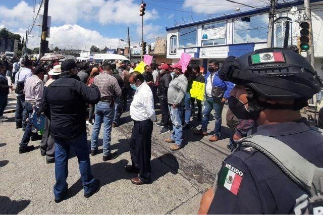 Tras acuerdo, transportistas abren accesos en Tlatlauquitepec