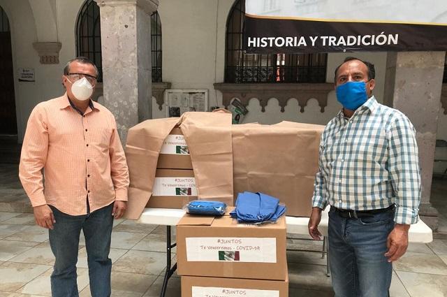 Furor de Jalacingo dona a Teziutlán trajes sanitarios contra Covid-19