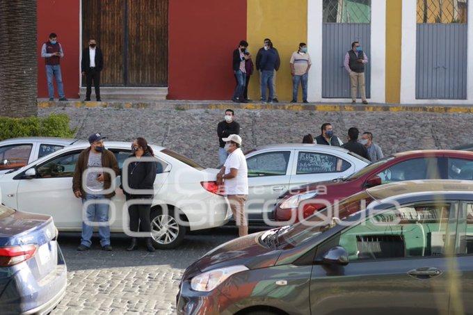 Choferes de Uber protestan en Puebla por tarifas e inseguridad