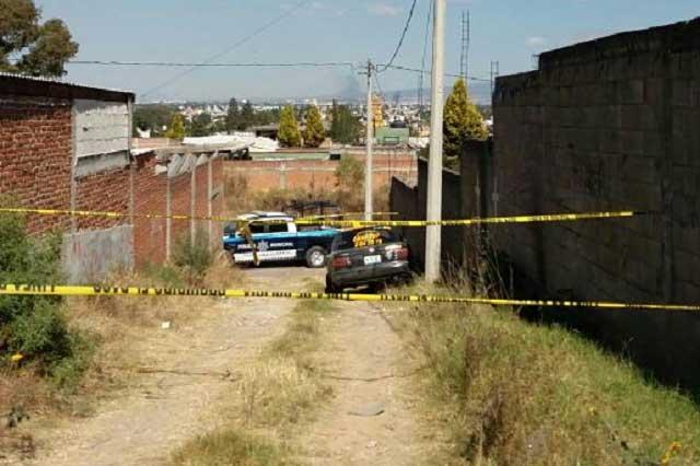 Hallan cadáver en la cajuela de un taxi, en San Andrés Cholula