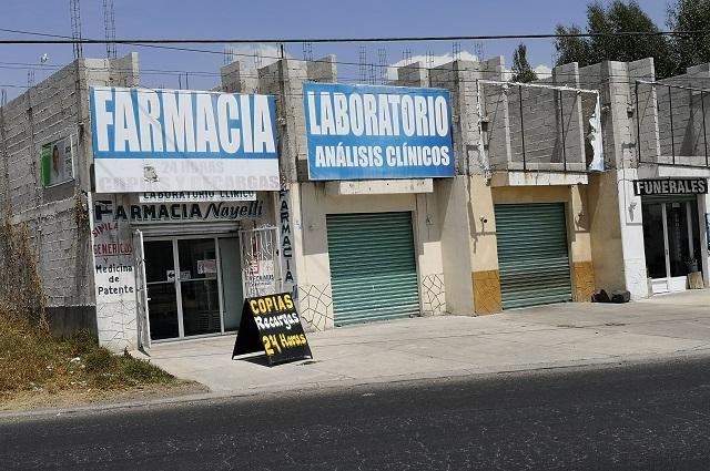 Farmacias de Cholula aumentan precios por Covid-19