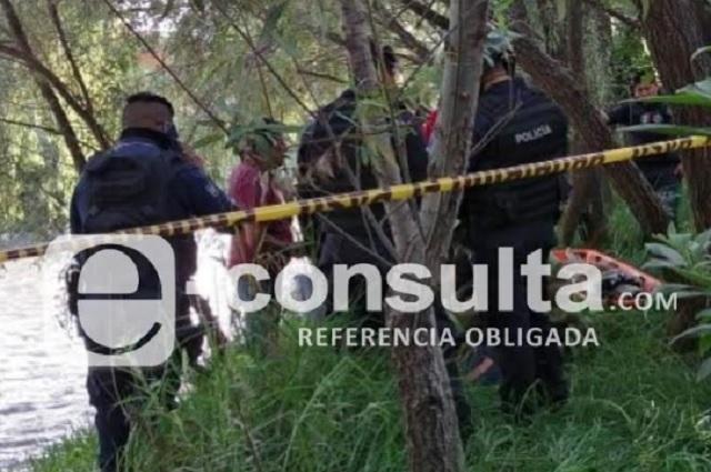 Hallan cadáver de mujer golpeada en el río Atoyac en Texmelucan