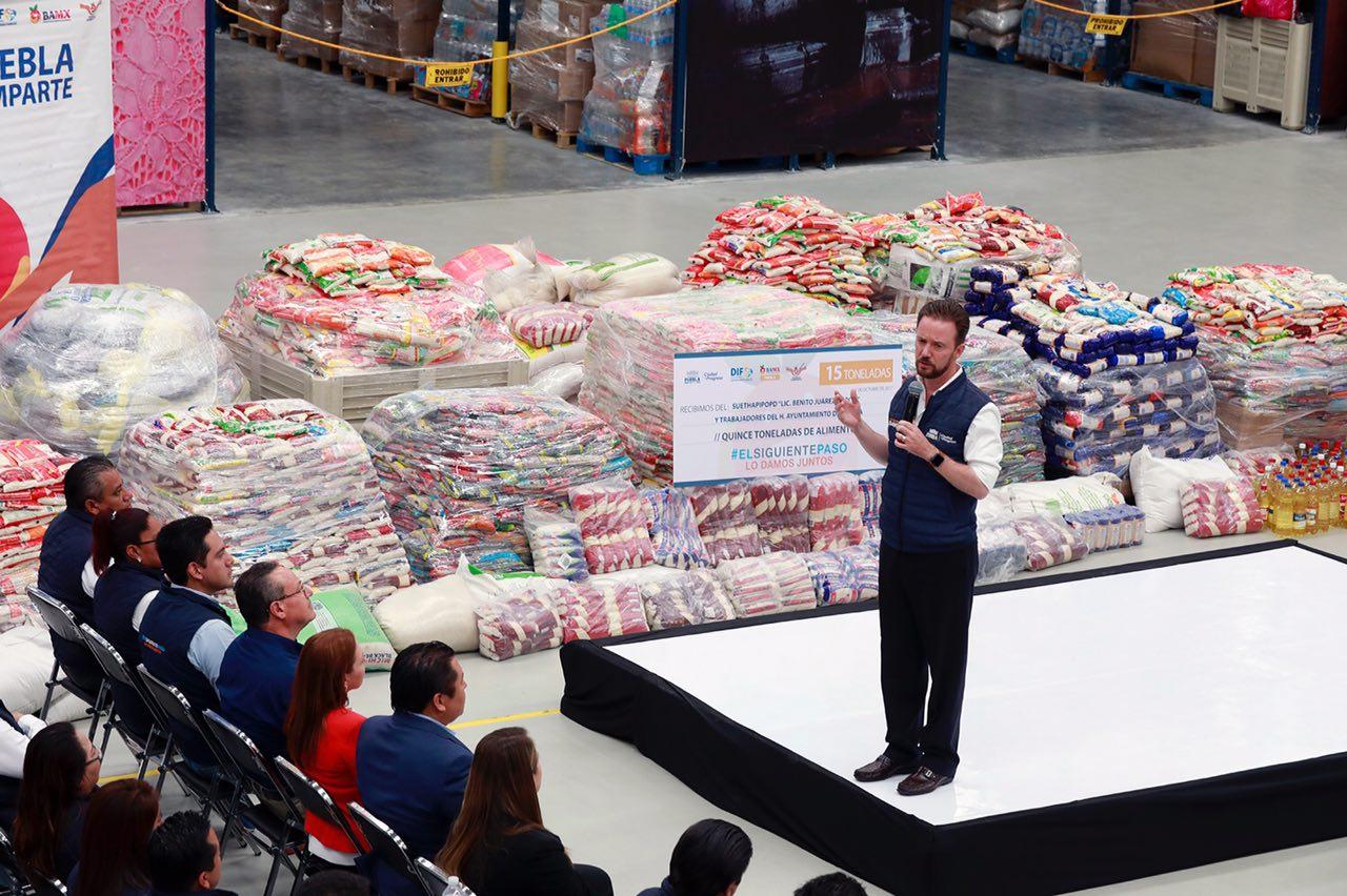 Trabajadores entregan 15 toneladas de alimentos a Puebla Comparte
