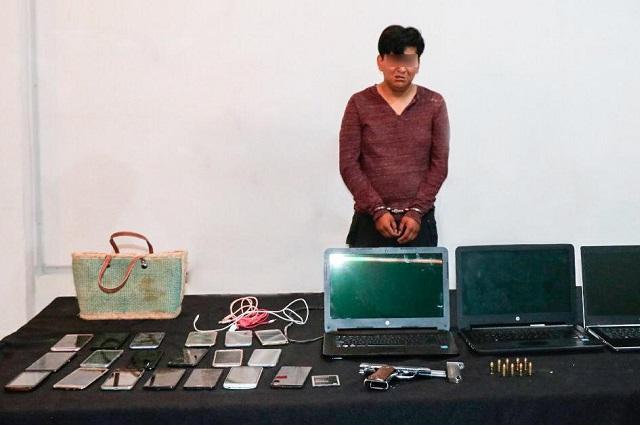 Ladrón llevaba 19 celulares, 3 computadoras y un arma de fuego