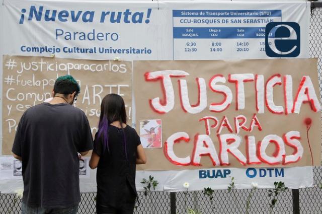 Protestan en BUAP por muerte de egresado en separos de Xoxtla