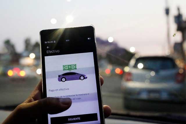 ONG pide frenar reforma para regular a Uber y Cabify en Puebla