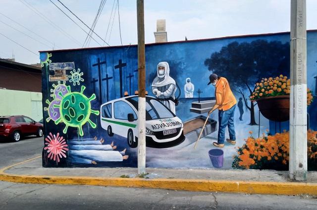 Artistas atlixquenses plasman la pandemia en un mural