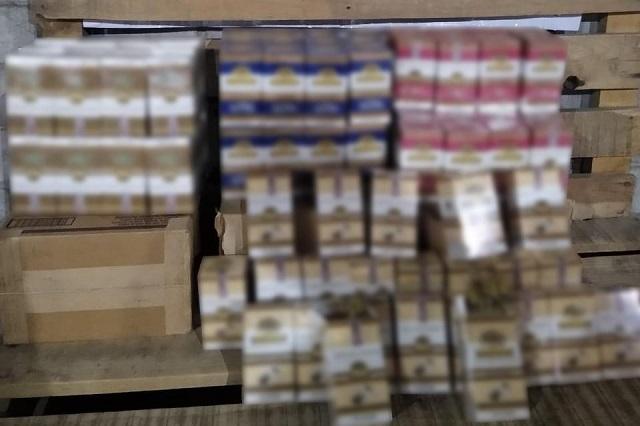 Incautan GN carga de cigarros ilegales en paquetería de Puebla