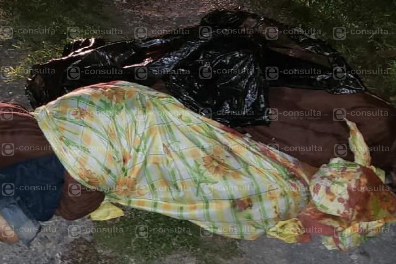 Tiran cadáver en la Puebla-Atlixco, degollado y envuelto en bolsas