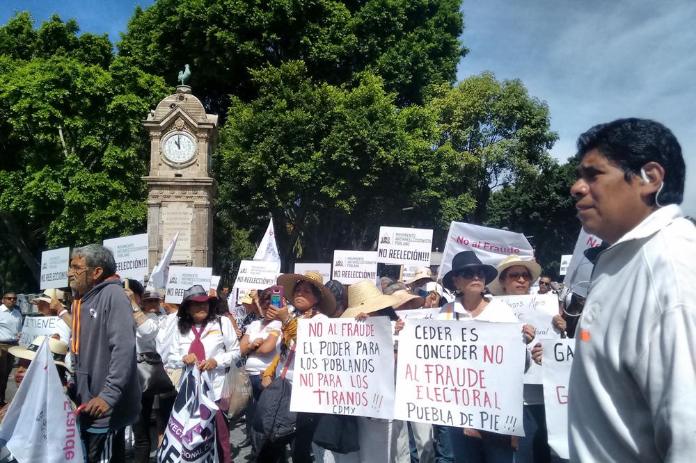 Marchan inconformes contra resultados electorales en Puebla
