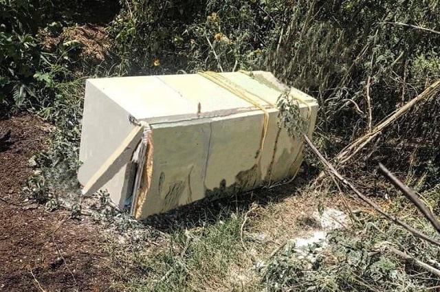 Dejan refrigerador con cadáver decapitado en Tecamachalco