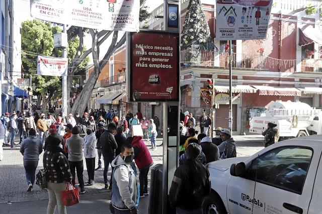 Ni 50% de formales y ambulantes acatan confinamiento en Puebla