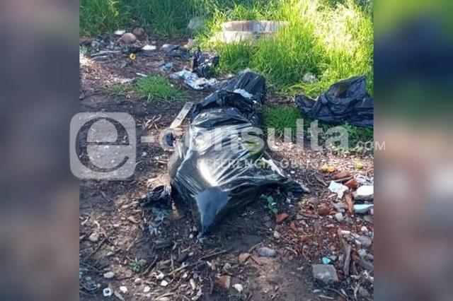 Hallan cuerpo embolsado en límites de Puebla y Tlaxcala