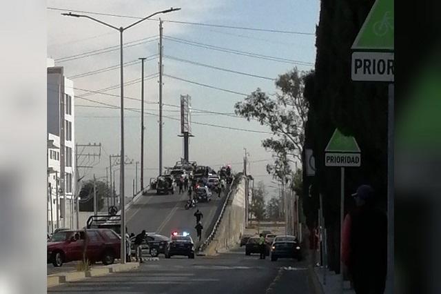 Asalto a First Cash Cholula deja un policía herido y 5 detenidos