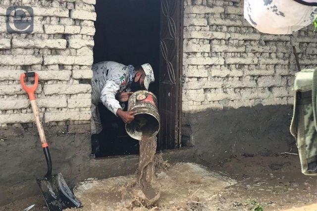 Lluvias provocan inundaciones en junta auxiliar de Izúcar
