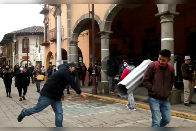 A laminazos exigen uso correcto del cubrebocas en Huauchinango