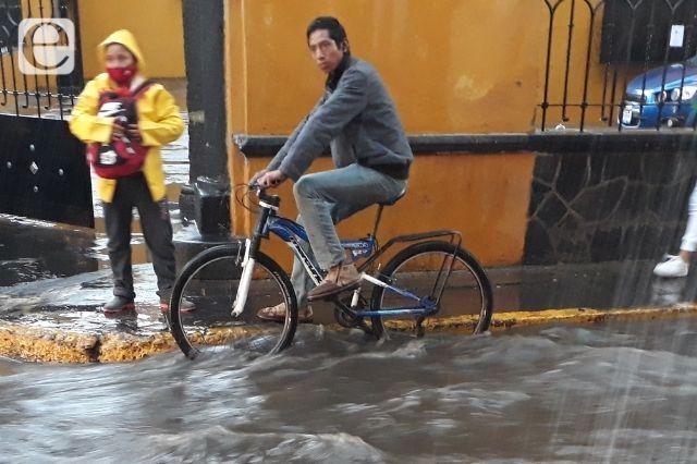 Crecen inundaciones y daños por lluvias en Atlixco