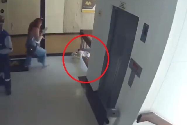 Madre se distrae con celular, su hijo cae en edificio y ella lo salva