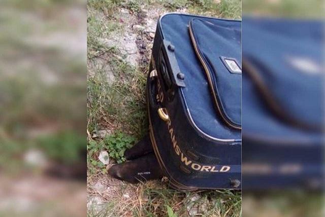Dejan desmembrado en una maleta con narcomensaje, en Atlixco