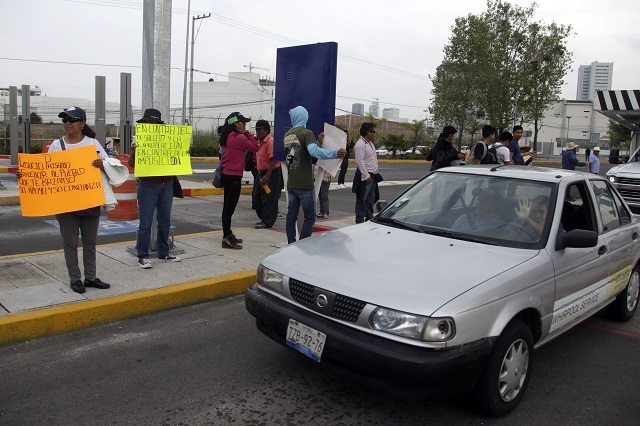 En Cacalotepec se deslindan de bloqueo en caseta de Atlixcáyotl