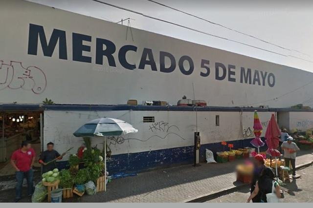 Grupo busca control del mercado 5 de Mayo con apoyo de la SSP, acusan